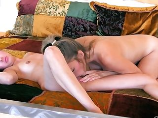 Captivating Bra-less Honeys Take A Sunbath And Make Love On The Couch